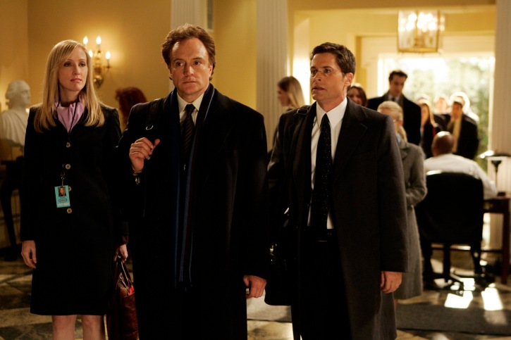 Bradley Whitford flanked by co-stars Janel Moloney and Rob Lowe